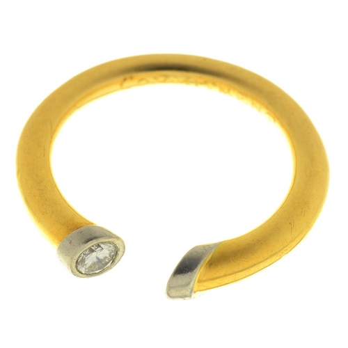 38 - A DIAMOND AND TWO COLOUR 18CT GOLD PENANNULAR RING, ENGRAVED COMMITMENT, IMPORT MARKED, LONDON 1996,...