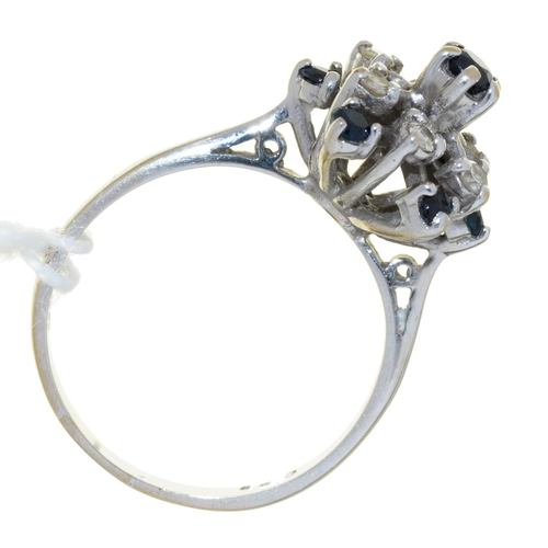 55 - A SAPPHIRE AND DIAMOND CLUSTER RING, IN 18CT WHITE GOLD, BIRMINGHAM 1975, 4.4G, SIZE M½...