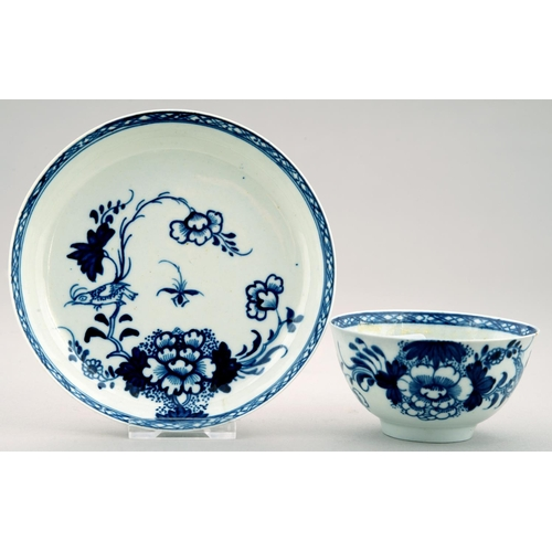 282 - A LIVERPOOL BLUE AND WHITE TEA BOWL AND SAUCER, PHILIP CHRISTIAN, C1765, PAINTED WITH THE BIRD ON A ...