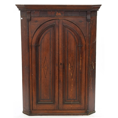 761 - A GEORGE III INLAID OAK CORNER CUPBOARD, THE ARCH PANELLED DOORS WITH LION PATERAE, 135CM H; 101 X 6...
