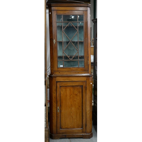 782 - A GEORGE III OAK STANDING CORNER CUPBOARD, EARLY 19TH C, THE LOWER PART WITH PANELLED DOOR, 205CM H;...
