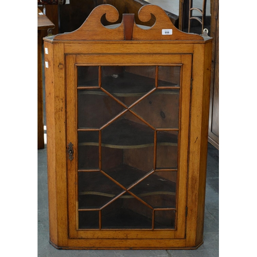 788 - A FRUITWOOD AND OAK HANGING CORNER CABINET, 19TH C AND LATER, WITH SWAN NECK PEDIMENT, 103CM H; 31 X...