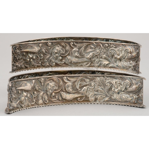 192e - A PAIR OF VICTORIAN SILVER CRESCENT SHAPED FLOWER HOLDERS, STAMPED IN HIGH RELIEF WITH GROTESQUES, B...