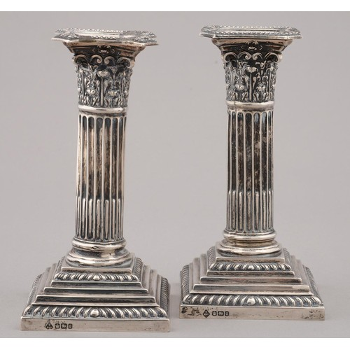 186a - A PAIR OF VICTORIAN DWARF SILVER COLUMNAR CANDLESTICKS WITH STOP FLUTED SHAFT AND CORINTHIAN CAPITAL...