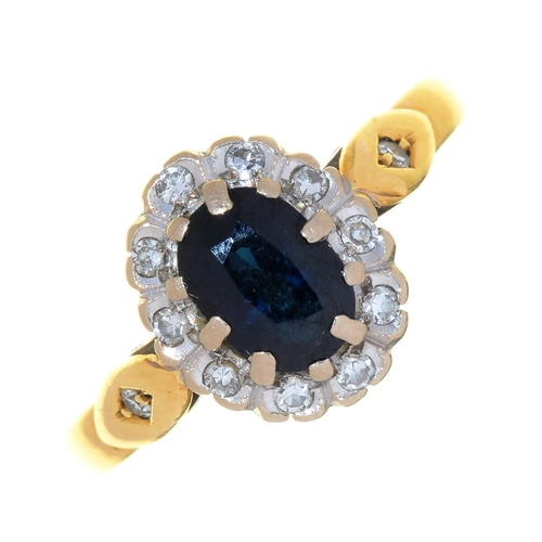 114 - A SAPPHIRE AND DIAMOND CLUSTER RING IN 18CT GOLD, 2006, 3.3G...