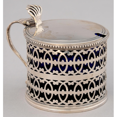 160 - A GEORGE V PIERCED SILVER MUSTARD POT WITH BEADED RIM, BLUE GLASS LINER, 73MM H, BY C SHAPLAND AND C...