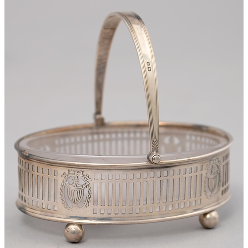 168 - A GEORGE V PIERCED SILVER BUTTER DISH WITH SWING HANDLE AND FROSTED GLASS LINER, 10.5CM L, BY PARKER...