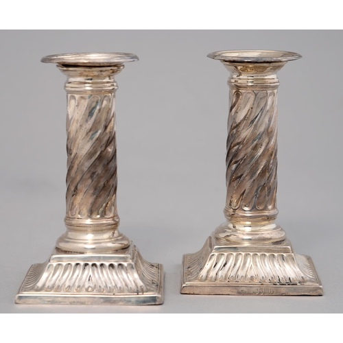 169 - A PAIR OF VICTORIAN SILVER DWARF COLUMNAR CANDLESTICKS, THE SPIRALLY FLUTED SHAFT ON SQUARE FOOT, NO...