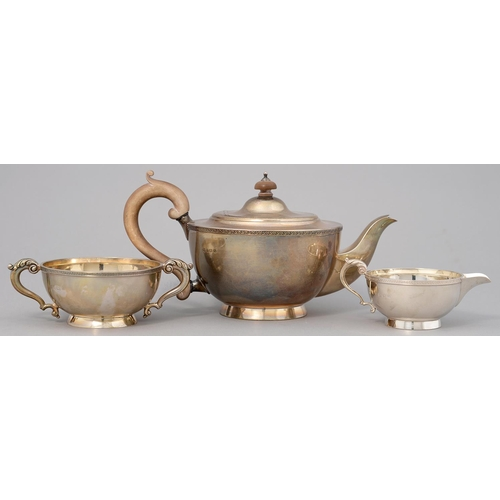 171 - A GEORGE V SILVER TEA SERVICE WITH APPLIED FOLIATE BORDER, TEAPOT 13.5CM H, BY WILLIAM NEALE LIMITED...