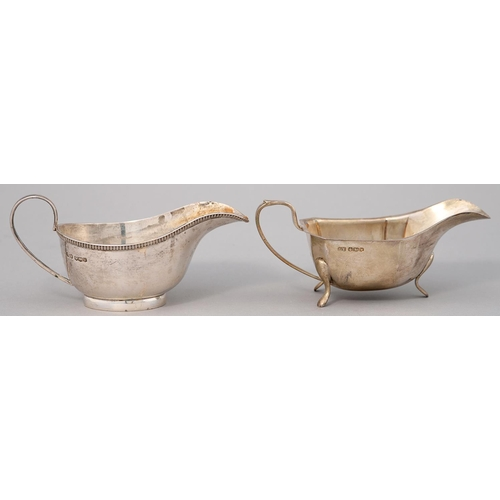 173 - A GEORGE V SILVER SAUCE BOAT ON THREE FEET, 16.5CM L, BY VINERS LTD, SHEFFIELD 1939 AND ANOTHER, SHE...
