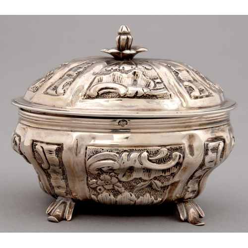 183 - AN ITALIAN   SILVER REPOUSSE SUGAR BOX AND COVER, MID 18TH C, OF BOMBE FORM, DECORATED WITH ROCAILLE...
