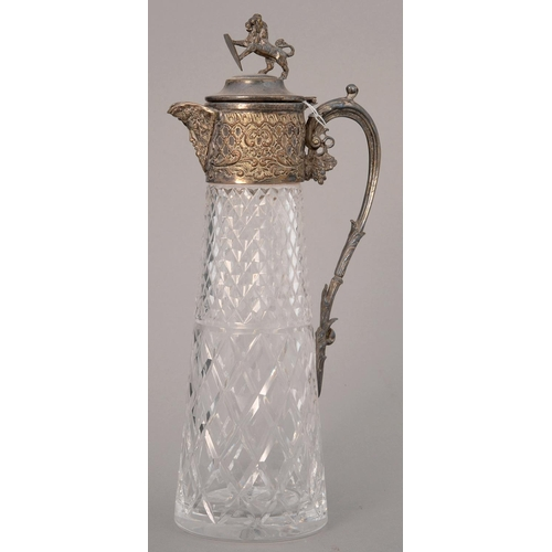 202 - A VICTORIAN EPNS MOUNTED CUT GLASS CLARET JUG, C1890 WITH LION FINIAL, 32CM H...