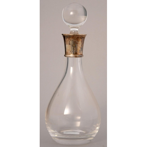 203 - AN ELIZABETH II SILVER MOUNTED GLASS BALUSTER DECANTER AND STOPPER, 32CM H, MAKER R AND D, SHEFFIELD...