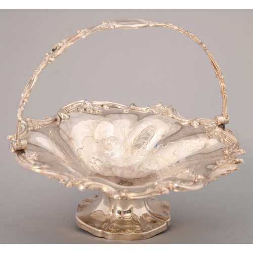 208 - A VICTORIAN SILVER CAKE BASKET, OF SPIRALLY LOBED FORM, CHASED AND APPLIED WITH C SCROLLS AND FOLIA...