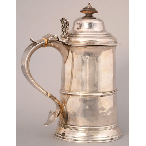 211 - A GEORGE III SILVER TANKARD WITH DOMED LID AND REEDED GIRDLE, THE TAPERING HANDLE WITH PIERCED THUMB...