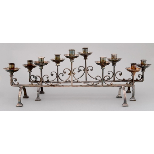 215 - A PAIR OF ARTS & CRAFTS EPNS CANDELABRA, C1930, OF FIVE LIGHTS LINKED BY C SCROLLS ON ARCHED LEG...