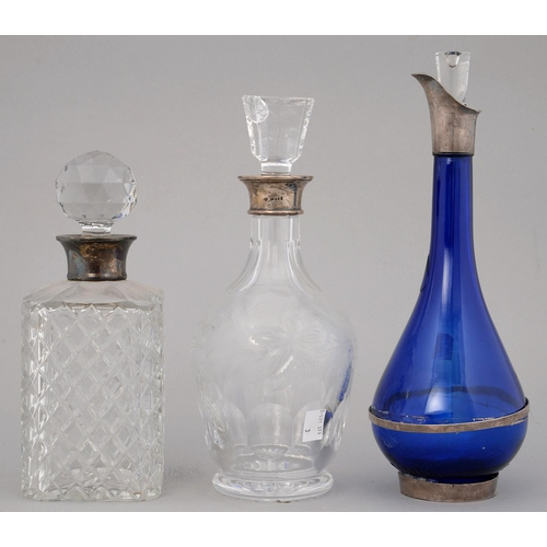 216 - AN ELIZABETH II SILVER  MOUNTED BLUE GLASS DECANTER AND STOPPER, 32CM H, MAKER VRL, 2002 AND A PAIR ...