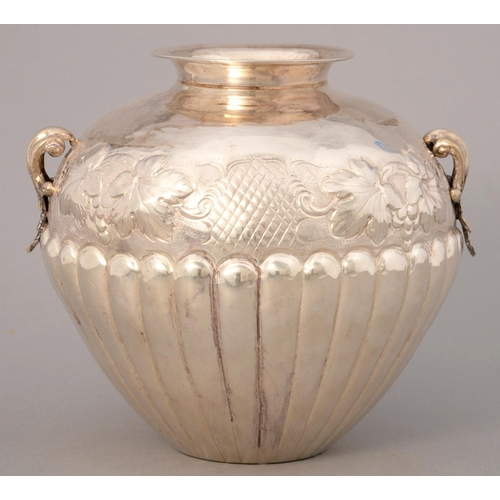 219 - A GREEK SILVER REPOUSSE AND LOBED GLOBULAR VASE, 20TH C, CHASED WITH GRAPES, CAST LEAF HANDLES, 15CM...