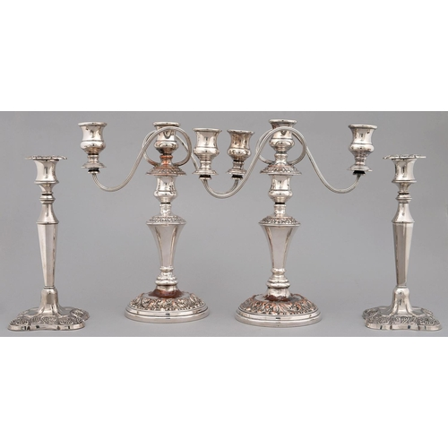 223 - A PAIR OF EPNS CANDELABRA OF THREE LIGHTS, 20TH C, HAVING REEDED SCROLLING BRANCHES AND LEAFY SCROLL...