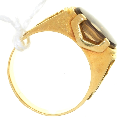 26 - A CITRINE RING, IN GOLD, INDISTINCT RUBBED FOREIGN CONTROL MARK, 8.9G, SIZE V...
