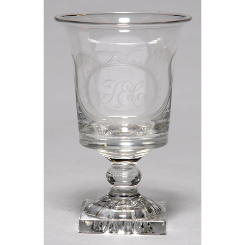 312 - AN ENGLISH GLASS RUMMER, C1800, THE FLARED BUCKET SHAPED BOWL ENGRAVED WITH INITIALS T E C IN AN OVA...
