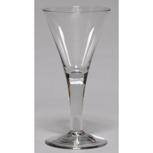 313 - AN ENGLISH GLASS GOBLET, C1770, THE FLARED BOWL ON SOLID STEM AND SPREADING FOOT WITH SHARP PONTIL S...