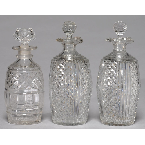 315 - ONE AND PAIR OF VICTORIAN CUT GLASS BARREL DECANTERS AND STOPPERS, C1840, 20CM...