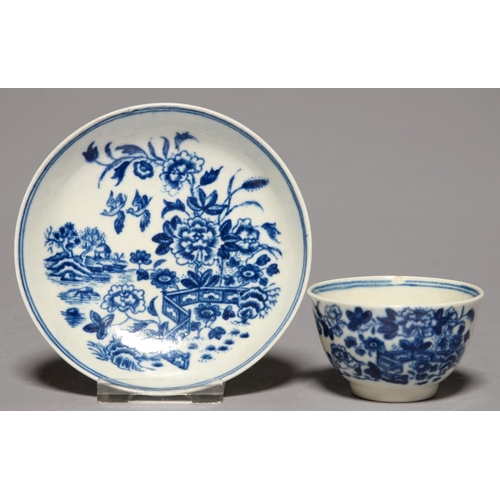 328 - A WORCESTER TOY OR MINIATURE BLUE AND WHITE TEA BOWL AND SAUCER, C1780, TRANSFER PRINTED WITH THE FE...