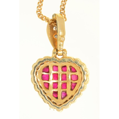 35 - A RUBY AND DIAMOND PENDANT OF HEART SHAPE WITH DIAMOND LOOP, IN GOLD MARKED 750, 20MM OVERALL AND A ...