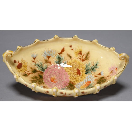 369 - A ZSOLNAY BOAT SHAPED DISH, C1890, DECORATED WITH FLOWERS IN GILT RIM, 27.5CM L, IMPRESSED ZSOLNAY P...