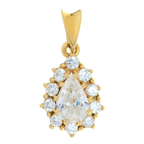 37 - A  DIAMOND  PENDANT, THE LARGER PEAR SHAPED DIAMOND APPROX 7 X 5MM, IN 18CT GOLD, IMPORT M...