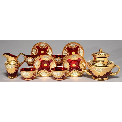 370 - A VENETIAN FLORAL ENCRUSTED AND GILT RUBY GLASS TEA SERVICE, SECOND HALF 20TH C, TEAPOT AND COVER 18...