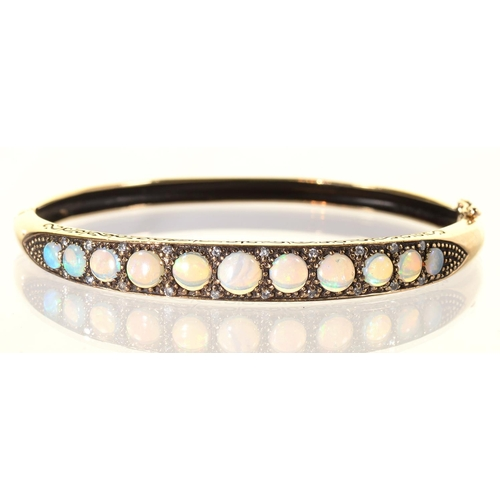 46 - AN OPAL AND WHITE STONE BANGLE IN 9CT GOLD, 58 X 64MM, BIRMINGHAM 2001, 13.5G...