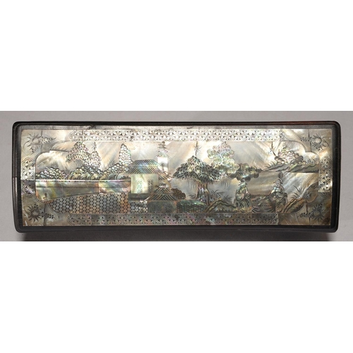 472 - A SOUTH EAST ASIAN MOTHER OF PEARL AND ABALONE INLAID AND EBONISED WOOD GLOVE BOX AND COVER, DECORAT...