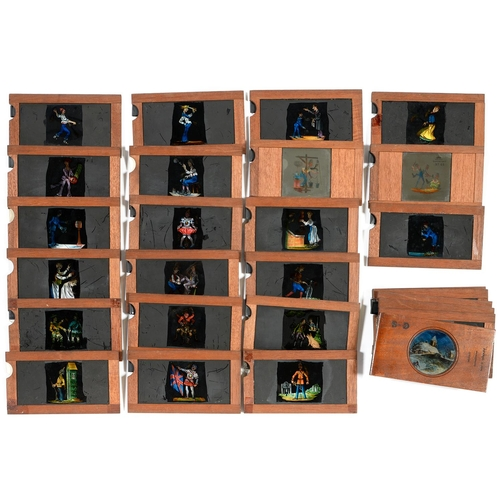 473 - TWENTY SIX COMIC  GLASS SLIPPING SLIDES  FOR USE WITH A MAGIC LANTERN, LATE 19TH C, SEVERAL WITH PRI...