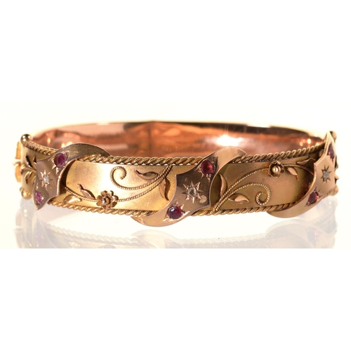 48 - A RUBY AND DIAMOND BANGLE, GIPSY SET AND APPLIED WITH FILIGREE, IN 9CT GOLD, 57 X 71MM, MAKER S BROS...