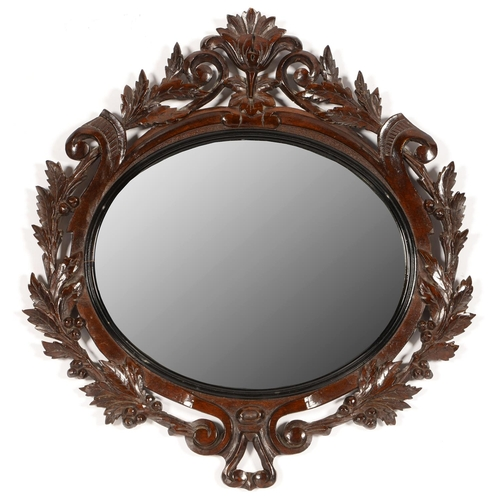 521 - A CONTINENTAL CARVED AND STAINED STAINED WOOD OVAL MIRROR, LATE 19TH C, THE UNBEVELLED OVAL PLATE I...