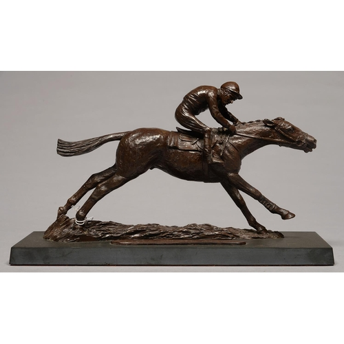 536 - A BRONZE RESIN SCULPTURE OF A RACEHORSE WITH JOCKEY UP, LATE 20TH C, ON SLATE BASE, 35CM L...