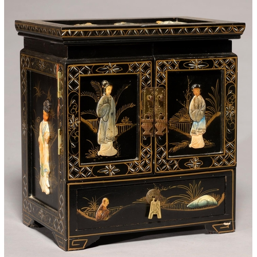 563 - A SOUTH EAST ASIAN LACQUER TABLE CABINET, APPLIED WITH POLYCHROME SOAPSTONE RELIEFS OF YOUNG WOMEN, ...