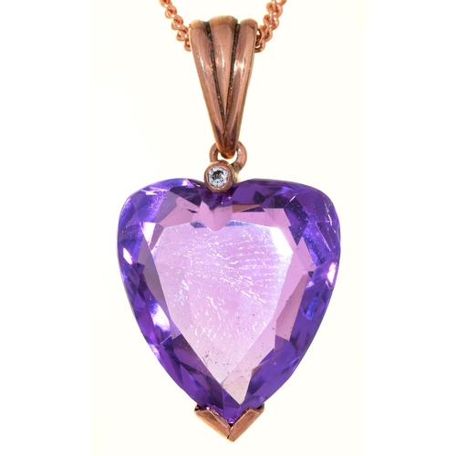57 - A HEART SHAPED AMETHYST PENDANT, EARLY 20TH C WITH DIAMOND ACCENT, GOLD LOOP, 29MM OVERALL AND A GOL...