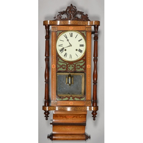 577 - AN AMERICAN INLAID WALNUT WALL CLOCK, LATE 19TH C, WITH TURNED PILLARS, PENDULUM, 90CM H...