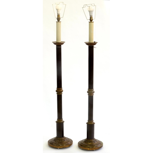 784 - A PAIR OF 'ANTIQUE' AND BLACK PATINATED BRASS ALTAR CANDLESTICK FORM STANDARD LAMPS, 20TH C, 125CM H...