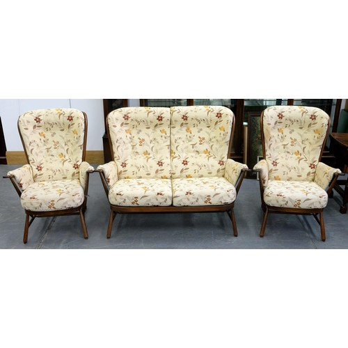 806 - AN ERCOL STAINED ASH THREE PIECE SUITE, COMPRISING SOFA, 140CM W AND PAIR OF ARMCHAIRS...