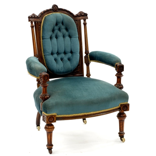 867 - A VICTORIAN WALNUT ARMCHAIR, THE BREAKARCHED BUTTONED BACK WITH RIBBON CARVED CRESTING AND FLUTED UP...