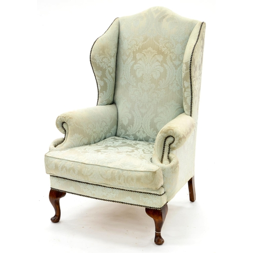 872 - A WING ARMCHAIR, EARLY 20TH C, IN GEORGE II STYLE, UPHOLSTERED IN CLOSE NAILED PALE GREEN BROCADE, S...
