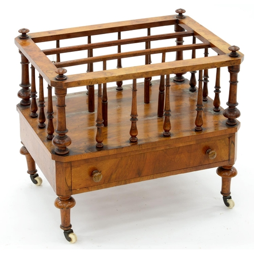 885 - A VICTORIAN WALNUT CANTERBURY, ON WHITE POTTERY CASTORS, 47CM H; 56 X 41CM
