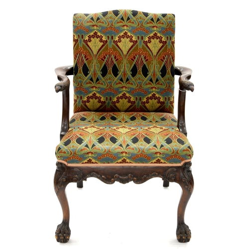 917 - A CARVED MAHOGANY ARMCHAIR, 20TH C, IN GEORGE II STYLE, THE ARMS TERMINATING IN AN EAGLE'S HEAD, THE...
