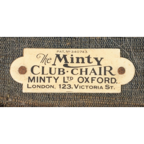 945 - A MINTY LTD CLUB CHAIR, C1930, WITH ADJUSTABLE BACK, IN THE ORIGINAL MUCH WORN BLUE UPHOLSTERY, SEAT...