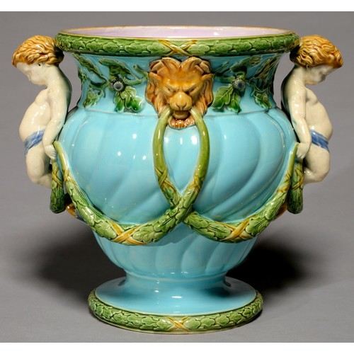 375A - A MINTONS SPIRALLY LOBED OGEE MAJOLICA JARDINIERE, C1870, WITH HORN HANDLE AND APPLIED WITH FESTOONS...