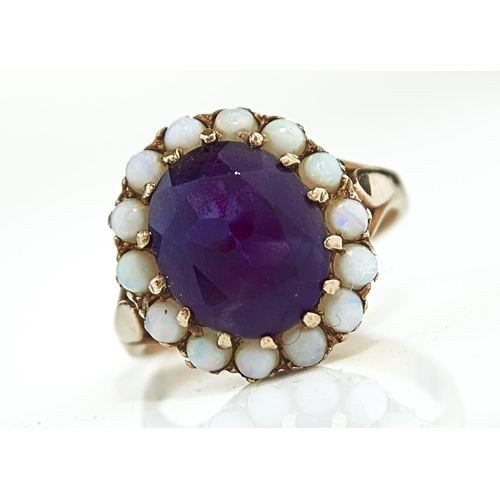 2 - AN AMETHYST AND OPAL CLUSTER RING IN 9CT GOLD, BIRMINGHAM, DATE LETTER RUBBED, 4.3G, SIZE P...